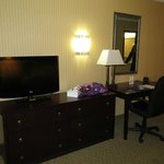 View of flat screen TV and desk area