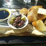 Artisan rustic breads, whole-roasted garlic & olives, £4.95