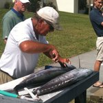 Johnny Walker cleaning a King Mackeral