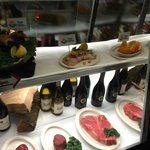 Display of fine wines and meat when you enter the restuarant