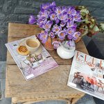 Enjoying coffee,pastry and recent mag on the canal deck