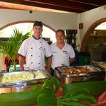 Smiling and attentive staff at lunchtime buffet