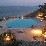 Swimming pool at sunset time
