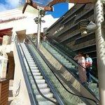 Escalator entrance on Lewers Street, not Kalakaua Avenue