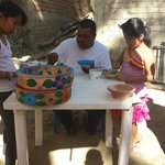 Francisco and his family painting bowls!