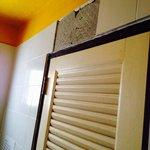 Missing Tiles above bathroom door
