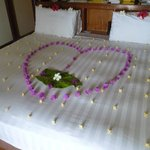 Our bed made up with fabulous flowers