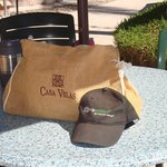 Casa Velas bag & Trip Advisor hat on pool table