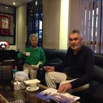 Guest enjoying coffee in lobby