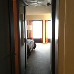 Looking into the bedroom from the hallway - corner suite. Bathroom on the L, walk in robe on the