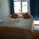 Room with balcony facing, north, the fantastic mountain views, shaded in the mornings for breakf