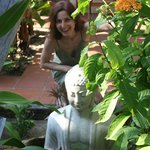 Me and Buddha hiding in the plants near the swimming pool