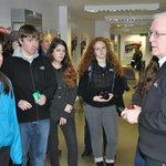 Students listen to John Kelly