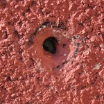 Bullet hole in building after shooting