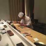 Japanese chef creating a masterpiece