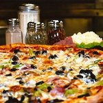 Our Authentic Brooklyn Special Pizza made fresh with our imported ingredients
