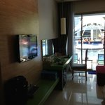 Flat screen with desk and balcony