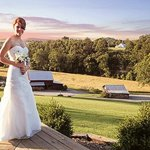 Bride at Creekside Resort with view from Mountain Lodge