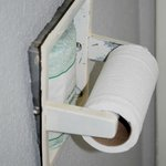 Tissue holder fell out of the wall.