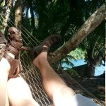 Relaxation in a hammock by the sea.