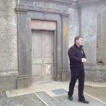 Alan in front of the original door way