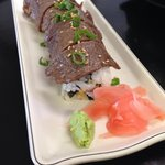 Surf & Turf Roll: Shrimp Tempura and Avocado, Topped with Bool Gogi and Toasted Sesame Seeds