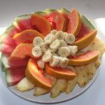 enjoy a tradfitional Belizean breakfast, including fresh, local watermelon, pineapple, banana, a