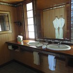 Large bathroom with robes/slippers, beach towels