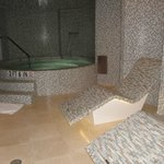 Spa-Jacuzzi and heated stone lounge chairs