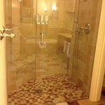 Lovely shower with a seat inside.