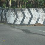 Turn Right at the Cement Wall Painted White with Black Stripes