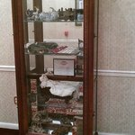 Glass case with antiques