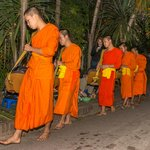 Monks collecting breakfast