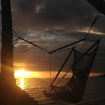 Watching the sunset from hammock chairs at Mango Bay Resort