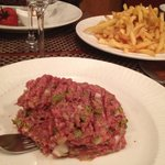 Steak Tartare, Fries, and Pigs Cheeks barely visible