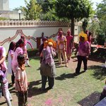 Playing Holi in the courtyard