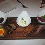 Sharing platter of pork - side garnish dishes
