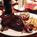 Four fat generous beef ribs from Wood Ranch, Ventura