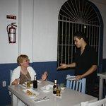 Ivan, UNICO´s great waiter, explains the menu.
