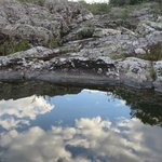 Reflections of clouds in a creek we stopped at during a ride.