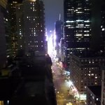 view from room at night looking at times square