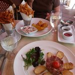 Steak tartare, pommes frites and fish & chips
