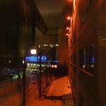 ночная подсветка отеля- вид из окна номера на вход в отель