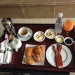 No room service - but breakfast served in your room.  Standard breakfast w/ side of bacon added