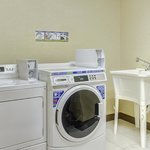 A coin-operated guest laundry is available