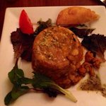 Mofongo stuffed w/ pepper tofu in creole sauce (a stray Arepa on side)
