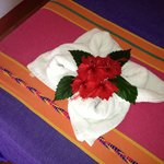 Towel with hibiscus upon arrival