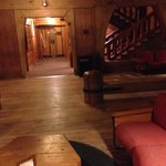 Lodge guest area...wrap around old fireplace with cozy couches, nooks for reading and board game