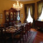 Formal dining room in which guests are served breakfast