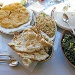 Palak Paneer, Naans, fried rice and Tibetan bread